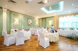 Hall in restaurant decorated for wedding celebration