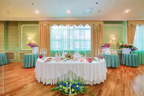 Beautifully decorated table for bride and groom