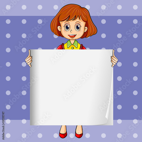 A girl holding an empty signage with a polkadot background