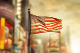 Tattered American flag blowing in the wind - 58518937