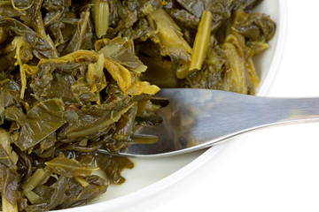 Close view of collard greens with a fork