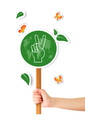 Hand holding green world peace sign