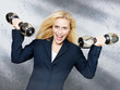 Business woman lifts free weights