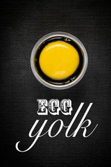Egg yolk on black with text