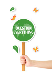 Hand holding green question everything sign