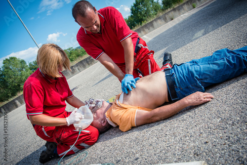 Paramedics succor a man with heart attack