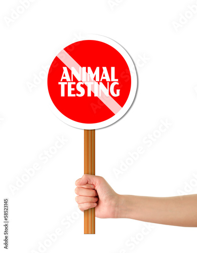 Hand holding red stop animal testing sign