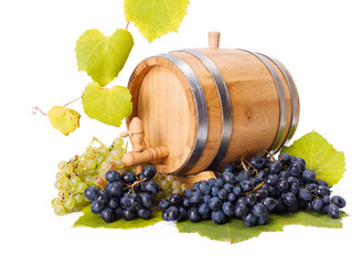White and blue grape clusters around barrel