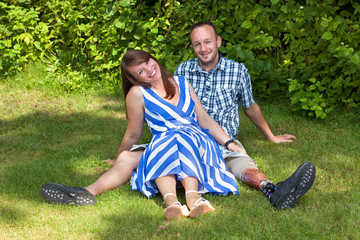 Happy attractive couple relaxing in the garden.