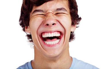 Happy teenage laugh closeup over white