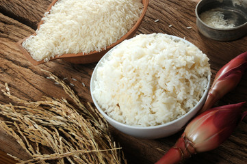 cooked rice, uncooked rice and paddy rice on wooden tabel