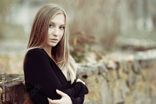 Portrait of a beautiful blonde girl close up