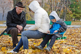 Family spending an autumn day in the park