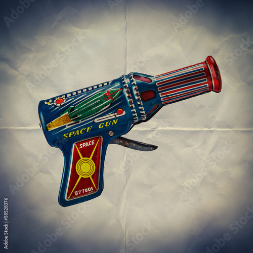 toy space gun paper backdrop
