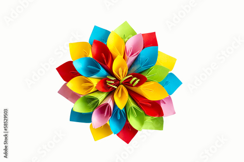 paper flower coloron a white background; viewed from above