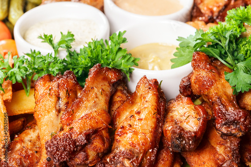 Fried meat of chicken with sauce