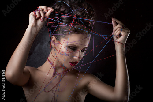 girl in a web of threads.