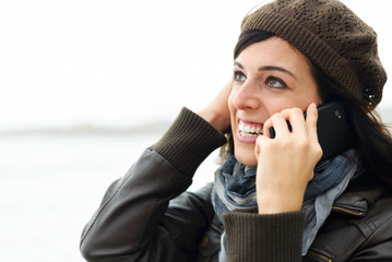 Casual woman on the cellphone outside