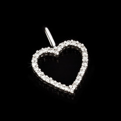 White gold pendant with diamonds in shape of heart