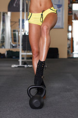 Sexy woman legs with kettlebell