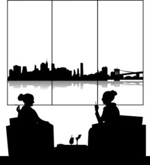 Silhouettes of girls in cafe drinking cocktails