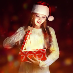 christmas, new year concept - Surprised girl in Santa hat