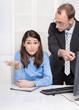 Streit am Arbeitsplatz, schlechtes Betriebsklima; Mann und Frau