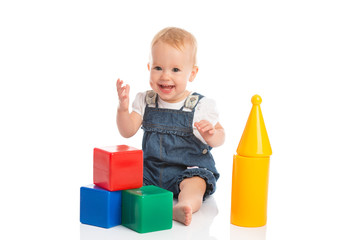 happy cheerful child playing with blocks cubes isolated on white