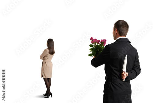 man going to metting and holding knife