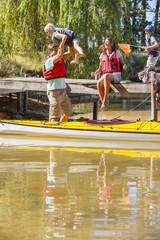 Family playing on dock at lake