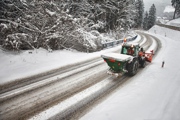 Tractor deicing a road