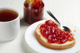 Piece of bread with jam and tea