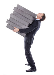 Businessman carrying high burden