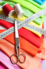 Example of Colorful fabric, scissors, meter and threads