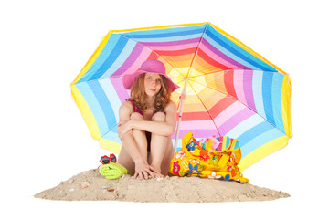 Sunbathing at the beach with colorful parasol
