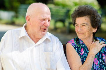 Senior man and woman smoking