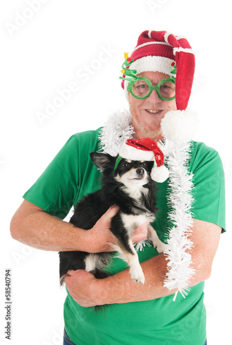 Senior man with little dog for Christmas