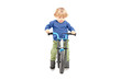 Cute male kid riding his bicycle
