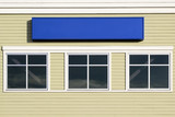 Blank Blue Sign Outside Commercial Building poster