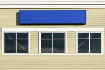 Blank Blue Sign Outside Commercial Building