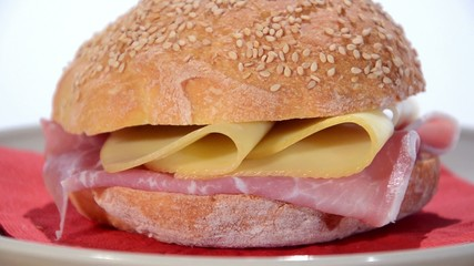 sesame seed bread with ham and cheese