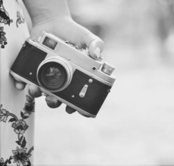 Close up of woman hand holding retro camera