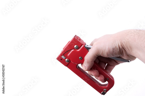 Construction stapler in a hand