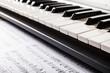 Sheet music and a piano keyboard - 58543339