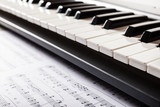 Sheet music and a piano keyboard