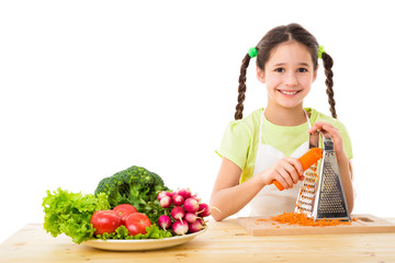 Girl grate the carrots