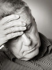 .Senior man with a headache