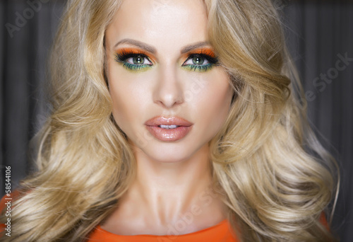Portrait of attractive blonde woman in makeup.