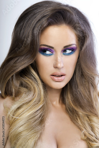Beautiful woman with colorful makeup.