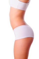 Young slim female body stretching